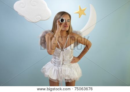Fashion model in angel costume is searching for her runaway love.