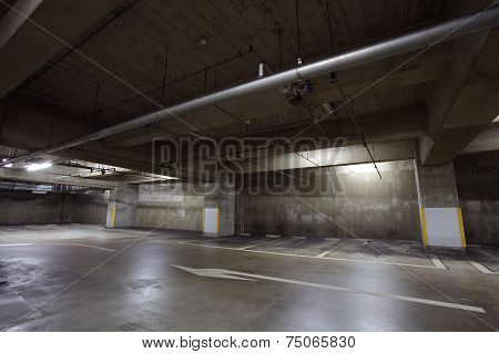 Empty underground car parking space at modern building