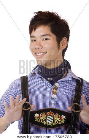 Young Asian In Bavarian Oktoberfest Leather Trousers (lederhose)