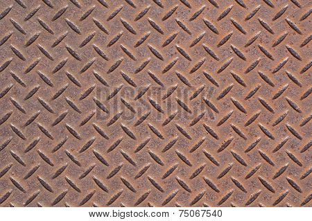 Rusty diamond metal plate texture and background