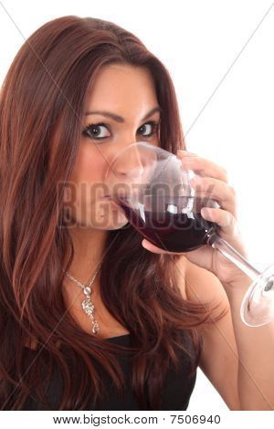 A Women Tasting A Glass Of Red Wine