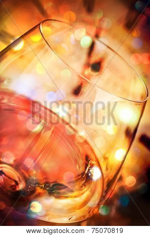 Wine and blurred clock in the background