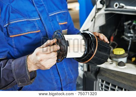 Car servicing, replacing of motor oil or fuel filter