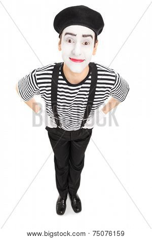 Vertical shot of a joyful mime artist isolated on white background