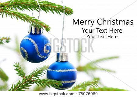 Christmas Fir Tree With Two Blue Christmas Balls With Merry Christmas