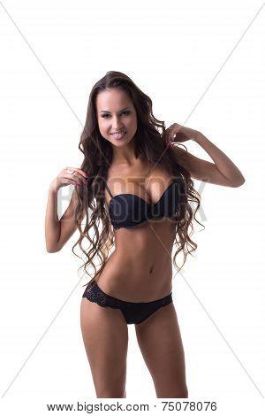 Beautiful long-haired brunette posing in lingerie