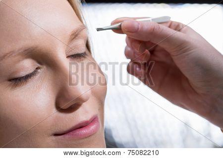Woman During Eyebrow Depilation