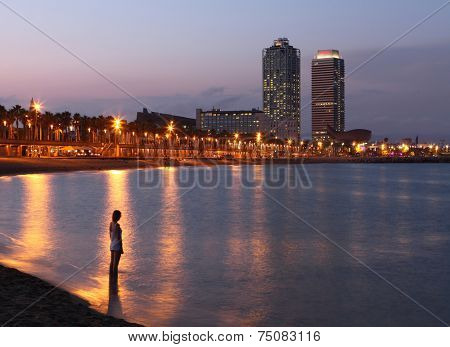 BARCELONA, SPAIN - AUGUST 15: Barceloneta beach and skyscrapers : Hotel Arts in the background on August 15, 2014 in Barcelona, Spain. The most famous view