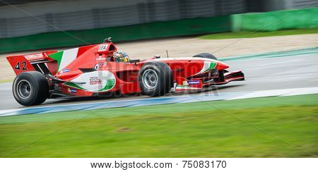 ASSEN, NETHERLANDS - OCTOBER 19, 2014: The Italian Formula A1 team and their car, driven by Mirko Bortolloti, finishes as runner up during the final races at TT Circuit Assen