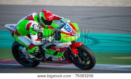 ASSEN, NETHERLANDS - OCTOBER 19, 2014: Competitor number 58 racing through the apex of the 1000cc superbike races on the TT Assen circuit