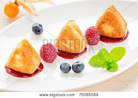 Fried Camembert Cheese With Raspberry Coulis And Mint And Fresh Berry For Decoration