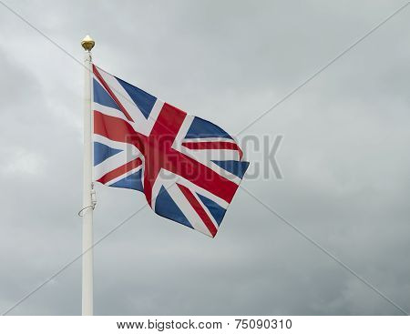 Great britain flag against a dark stormy sky
