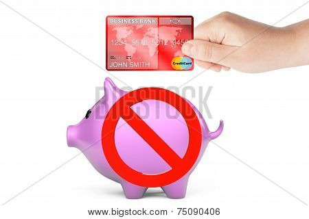 Credit Card In Hand With Piggy Bank And Prohibition Symbol