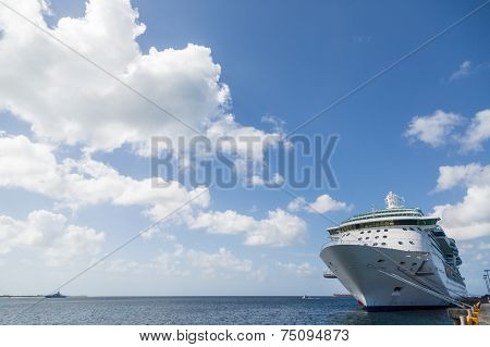 Cruise Ship Anchored At Pier With Beautiful Sky