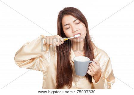 Asian Woman In Pajamas Clean Her Tooth With Toothbrush