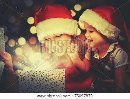 Christmas Magic Gift Box And A Happy Family Mother And Daughter Baby Girl