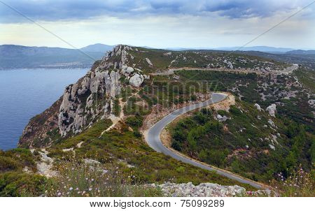 Mountain serpentine with many dangerous turns. Road near to Mediterranean sea at island of Crete, Greece. typical  landscape on Crete
