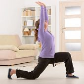 picture of qi  - Beautiful woman doing qi gong tai chi exercise at home - JPG