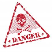 picture of dangerous  - Colorful grunge rubber office stamp with skull shape and the word danger written under the skull symbol - JPG