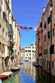 picture of gondolier  - One of channels in Venice - JPG