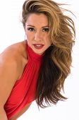 picture of halter-top  - Beautiful brown haired woman in a red halter top - JPG