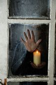 stock photo of torture  - Mystic photo of female hand on  dirty old glass - JPG