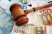 picture of court hammer  - Court gavel over assorted Euro notes  - JPG