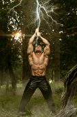 pic of swords  - Action Hero Muscled Man Holding A Ancient Sword  - JPG