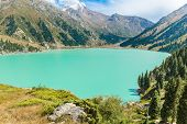 stock photo of shan  - Spectacular scenic Big Almaty Lake Tien Shan Mountains in Almaty KazakhstanAsia at summer - JPG