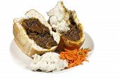 Two South African Mutton Bunny Chows With Carrot Sambal poster