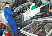 picture of assemblage  - auto repairman industry mechanic worker servicing car auto in repair or maintenance shop service station - JPG