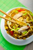 stock photo of crispy rice  - Chicken curry rice with crispy chinese omellete chinese chopsticks