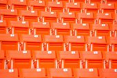 stock photo of bleachers  - the red seats on stadium steps bleacher - JPG