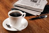 foto of peppy  - cup of coffee and the newspaper and pause at work - JPG