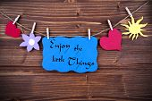 image of blue things  - The Phrase Enjoy The Little Things On A Blue Label Hanging On A Line With Different Symbols - JPG