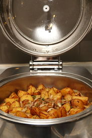 foto of chafing  - Chafing dish heater filled with ready food inside - JPG