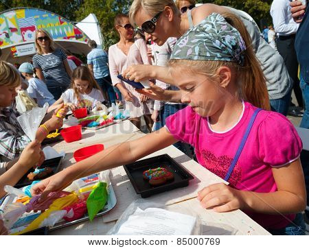 Children Making Cakes During Apple Feast Day