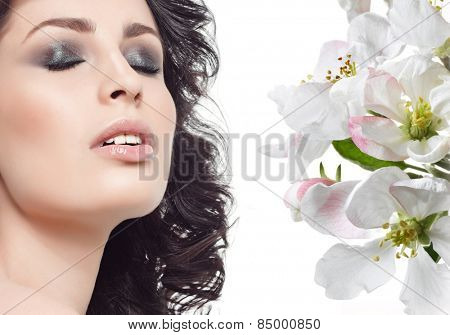 closeup portrait of attractive  caucasian smiling young woman brunette isolated on white studio shot lips face hair eyes closed makeup lips sexy spring flowers
