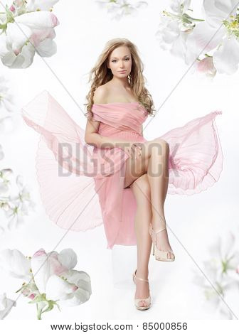 beauty romantic woman in pink dress isolated on white background legs face spring flowers hair studio shot