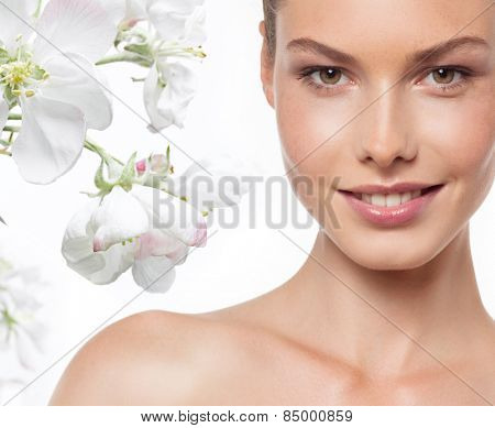closeup portrait of attractive  caucasian smiling woman brunette isolated on white studio shot lips toothy smile face head and shoulders looking at camera tooth spring flowers