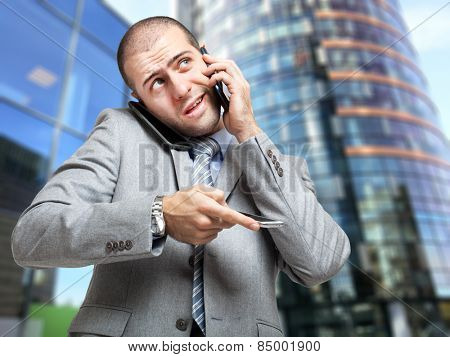 Businessman explaining something at the phone
