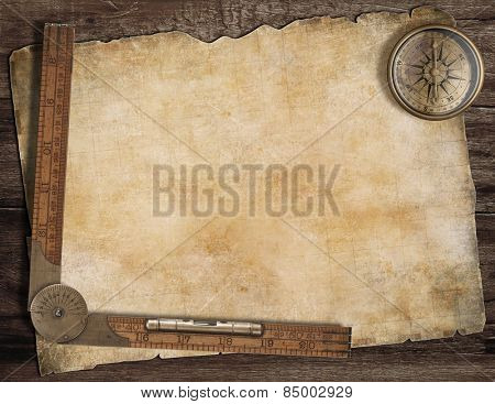 Old treasure map background with compass and wood ruler. Exploration concept.