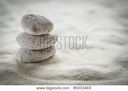 zen stones on the sand background