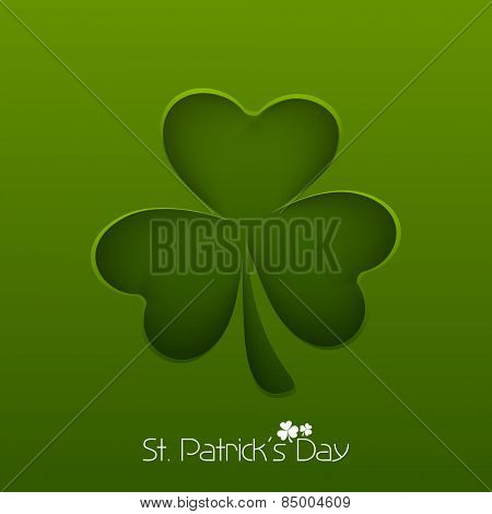 Irish lucky clover leaf on green background for Happy St. Patrick's Day celebration.