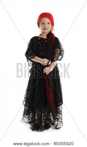 Little girl in costume of a witch isolated on white