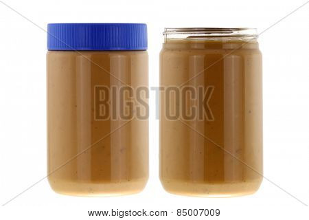 Jars full of of creamy crunchy peanut butter isolated on white background