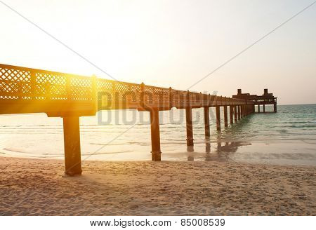 Pier on the Dubai Jumeirah beach at dusk