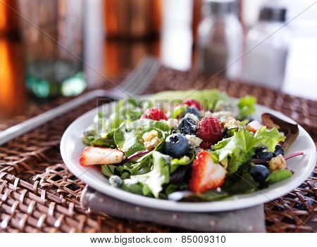 tasty berry salad with blue cheese crumbles and walnuts