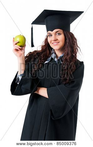 Beautiful graduate girl student in mantle with green apple, isolated on white background