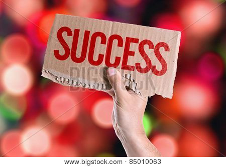 Success card with colorful background with defocused lights